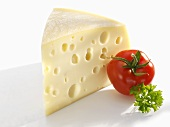 Piece of Emmental cheese, tomato and parsley