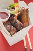 Crispy fried pork ribs with sauce to take away