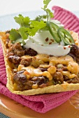 Chili con carne with cheese in corn shell (Mexico)