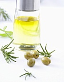 Olive oil, green olives and rosemary
