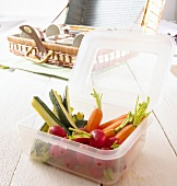 Raw vegetables in plastic container for a picnic