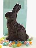 Chocolate Easter Bunny surrounded by jelly beans