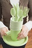 Woman holding picnicware