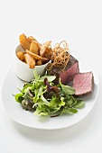 Beef fillet with deep-fried onions, salad & potato wedges