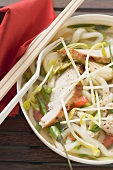 Spicy noodle soup with chicken and vegetables (Asia)