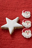 Cinnamon star and Father Christmases on red felt