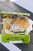 Chicken sandwich and crisps in lunch box