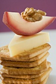 Piece of Emmental cheese, red wine pear & walnut on crackers