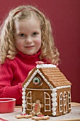 Small girl with gingerbread house
