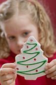 Small girl holding Christmas biscuit