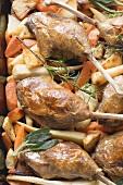 Roasted duck legs on root vegetables