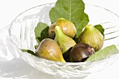 Fresh figs with leaves in crystal bowl
