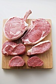 Various cuts of beef on chopping board