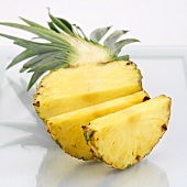 Half a pineapple, partly sliced