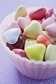 Coloured hearts in small pink dish