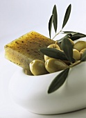 Olive soap and green olives in small bowl