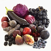 Still life with purple fruit and vegetables
