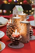 Burning candles on Christmas table
