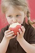 Little girl eating apple