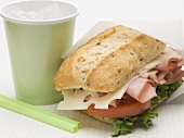 Ham, cheese, lettuce and tomato sandwich, drink
