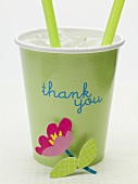 Iced water in cup with the words 'thank you' and flower