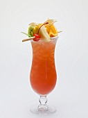 Cocktail with exotic fruit skewer