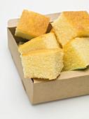Cubes of cornbread in cardboard box
