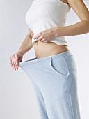 Woman inspecting her slim waist