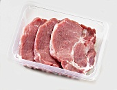 Pork neck steaks in plastic container