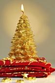 Gold Christmas candle on napkins