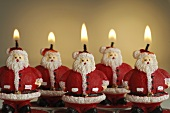 Several Father Christmas candles