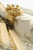 Fabric napkin with gold napkin ring (Christmas)