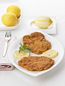 Wiener schnitzel (breaded veal escalope) with lemons