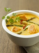 Salmon soup with asparagus and chilli rings