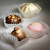 Four different chocolates in paper cases