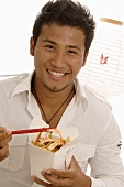 Man with Asian take-away