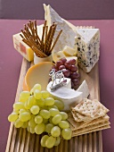 Cheese board with grapes and nibbles