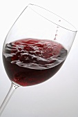 Red wine swirling in a glass