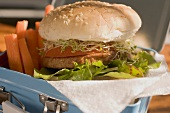 Burger and vegetables in lunch box