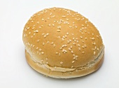A hamburger bun with sesame seeds