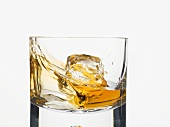 Whisky swirling in a glass