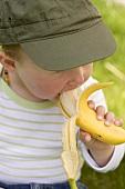 Baby eating a banana