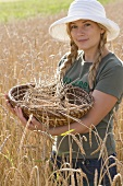 Woman with basket in a corn field