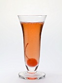 Sparkling wine cocktail with cocktail cherry