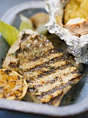 Grilled fish fillet with baked potato