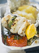 Grilled fish and vegetable skewer with baked potato