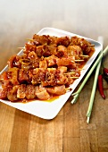 Raw marinated meat skewers