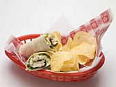 Wraps with crisps in a plastic basket