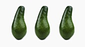 Three pear-shaped avocados