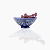 Red grapes in striped dish